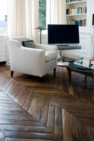 engineered herringbone floorings and sitting sofa