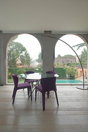 modern glass design table and pink chairs vassalletti creation rome